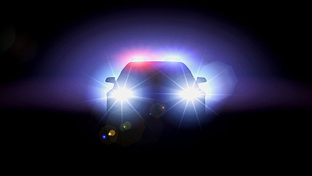 police-car-with-headlights-on_100391256_m